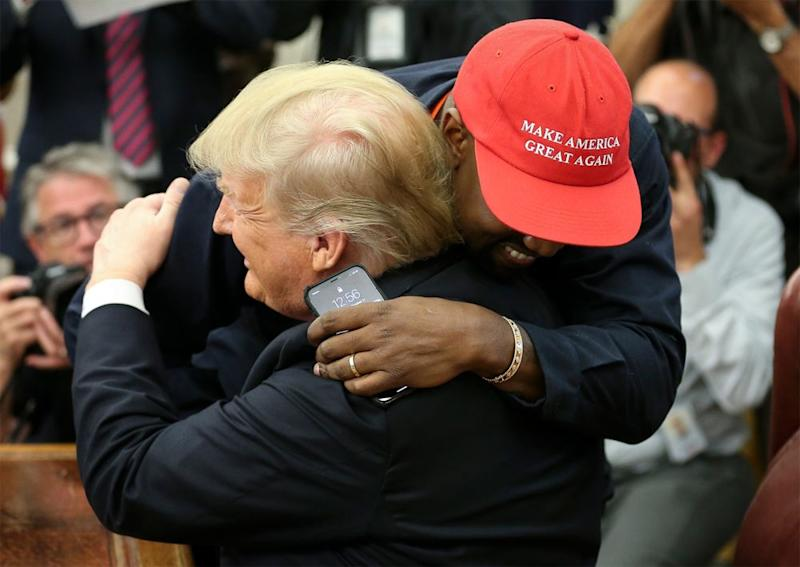 Kanye West hugs President Donald Trump during an Oval Office visit in October | Oliver Contreras - Pool/Getty