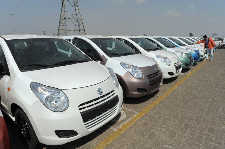 Maruti Suzuki Alto cars to be exported out of India are parked at a holding area in Mundra on February 19, 2011