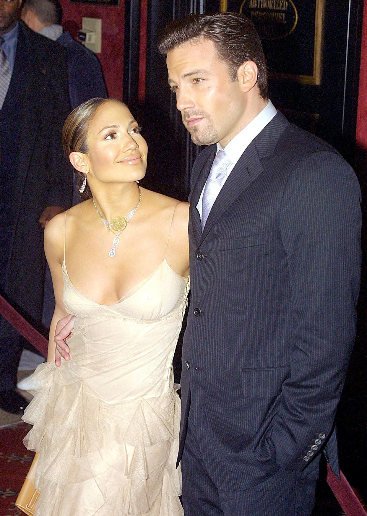 Jennifer Lopez and Ben Affleck arrive at the premiere of Lopez's new film 'Maid in Manhattan' in New York City on 8 December 2002. (Getty Images)