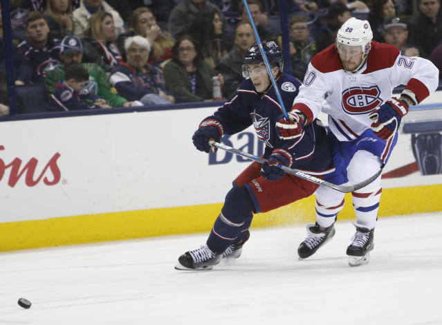 Columbus Blue Jackets' Zach Werenski, left, and Montreal Canadiens' Nicolas Deslauriers chase the puck during the third period of an NHL hockey game Monday, March 12, 2018, in Columbus, Ohio. (AP Photo/Jay LaPrete)
