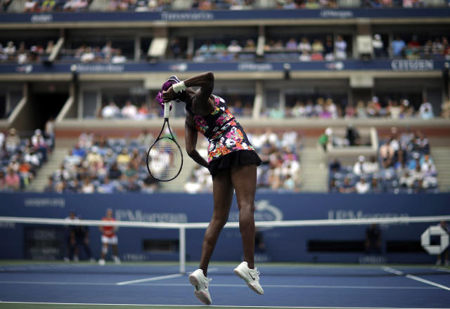 <p>Venus Williams serves to Belgium's Kirsten Flipkens during the first round of the 2013 U.S. Open tennis tournament, Aug. 26, 2013, in New York. Williams defeated Flipkens. (AP Photo/David Goldman) </p>