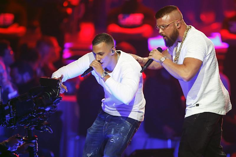 German rappers Kollegah and Farid Bang perform during the 2018 Echo Music Awards ceremony in Berlin on Thursday