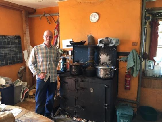 Lea Trainer in the communal farm house kitchen – complete with wood-burning oven (Colin Drury)