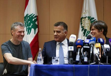 Canadian citizen, Kristian Lee Baxter, who was being held in Syria, shakes hands with Major General Abbas Ibrahim, Lebanon's internal security chief, after being released, at a news conference in Beirut