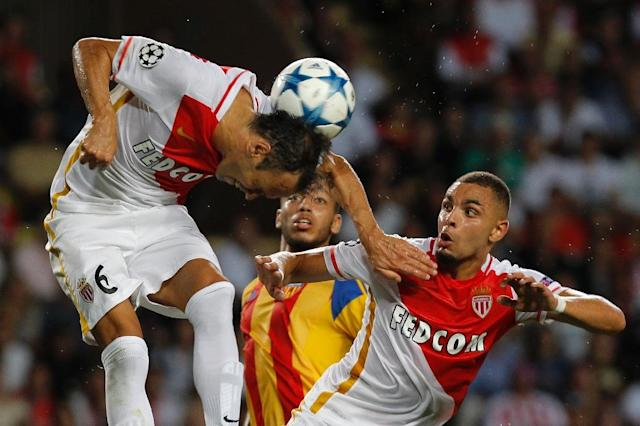 Monaco's Portuguese defender Ricardo Carvalho heads the ball during the UEFA Champions League playoff football match between AS Monaco FC vs Valencia CF, at the Louis II Stadium, in Monaco, on August 25, 2015 (AFP Photo/Jean Christophe Magnenet)