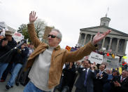 FILE - In this Wednesday, April 15, 2009 file photo, Phil Valentine takes the stage as Tea Partiers show up in mass on the War Memorial Plaza in Nashville, Tenn. Valentine, a conservative talk radio host from Tennessee who had been a vaccine skeptic until he was hospitalized from COVID-19 has died, Saturday, Aug. 21, 2021. He was 61. (Larry McCormack/The Tennessean via AP, File)