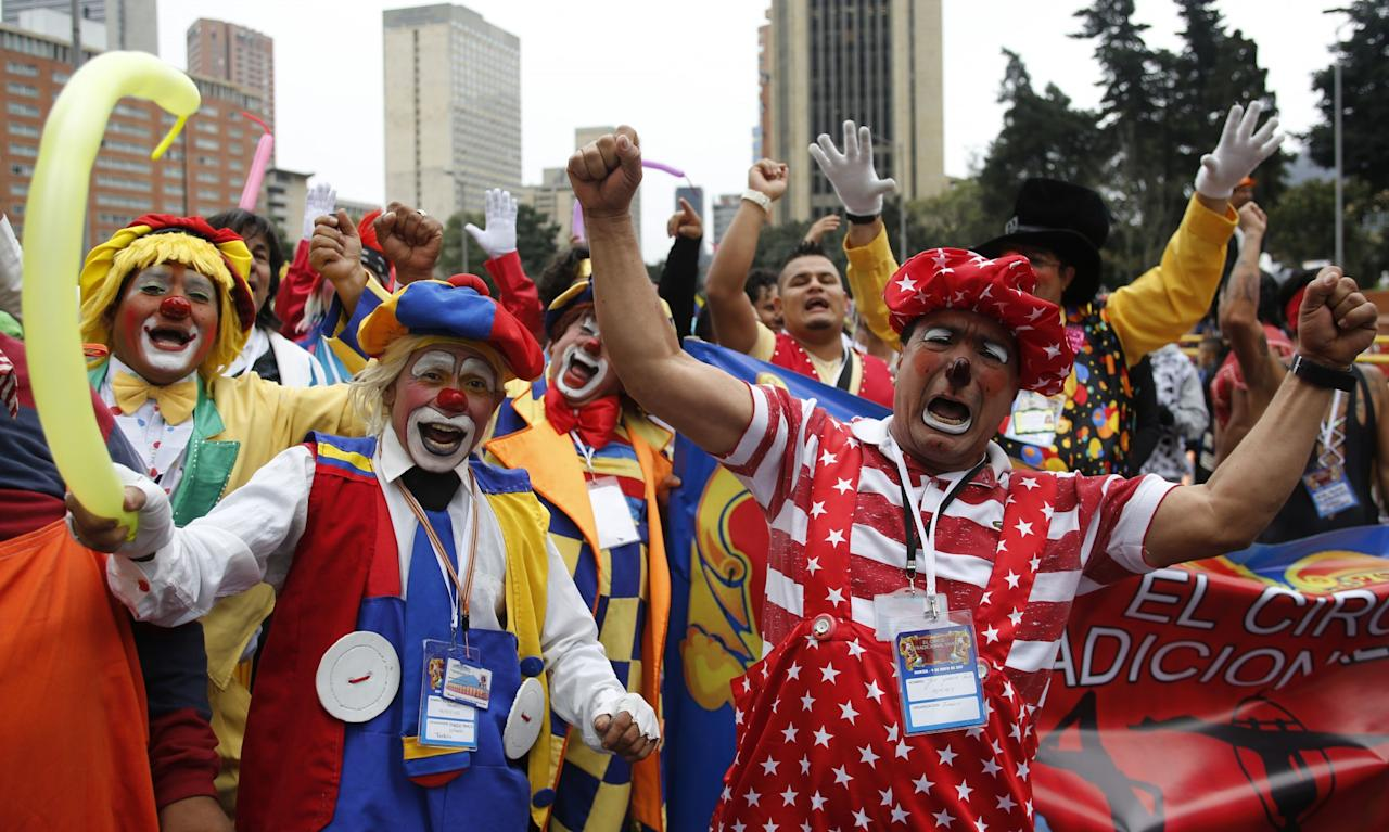 <p>Clowns hold an anti-government protest in Bogota, Colombia, to protest the government's economic policies, demand better job opportunities and better access to healthcare (Rex features) </p>