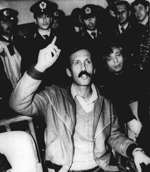 FILE – In this 1989 file photo Mohammed Rashed speaks during his trial in Athens, Greece, in connection with a fatal 1982 Pan Am 830 bombing. Rashed tucked a bomb beneath a jetliner seat cushion, set the timer and disembarked with his wife and child when the flight touched down in Tokyo. The device exploded as the jet continued on to Honolulu, killing a Japanese teenager in an attack that investigators linked to a terrorist organization known for making sophisticated bombs. It would be 20 years before the Jordanian-born bomber, and one-time apprentice to Abu Ibrahim, currently featured on the FBI list of most wanted terrorists, would admit guilt in an American courtroom. Now, credited for his cooperation against associates, Rashed is about to be freed from federal prison after more than two decades behind bars in Greece and the United States. (AP Photo/File)