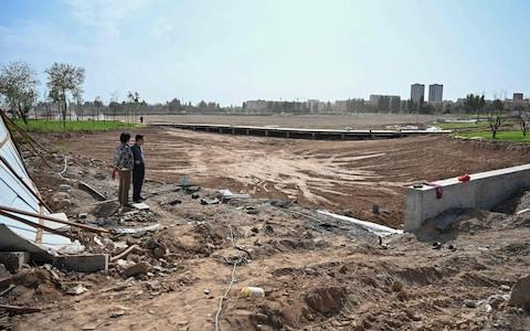 This photo taken on September 13, 2019 shows the works of a park in a place where before there was a Uighur cemetery in Kuche in the region of Xinjiang. - Credit: AFP