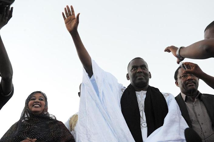 Mauritania anti-slavery activist Biram Dah Abeid waves at supporters as he takes part in a campaign rally on the last day of the national presidential election campaign, in Nouackchott, on June 19, 2014 (AFP Photo/Seyllou)