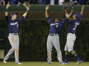 Milwaukee Brewers' Christian Yelich, left, Lorenzo Cain, center, and Keon Broxton celebrate their team's win over the Chicago Cubs in their baseball game Monday, Sept. 10, 2018, in Chicago. (AP Photo/Jim Young)