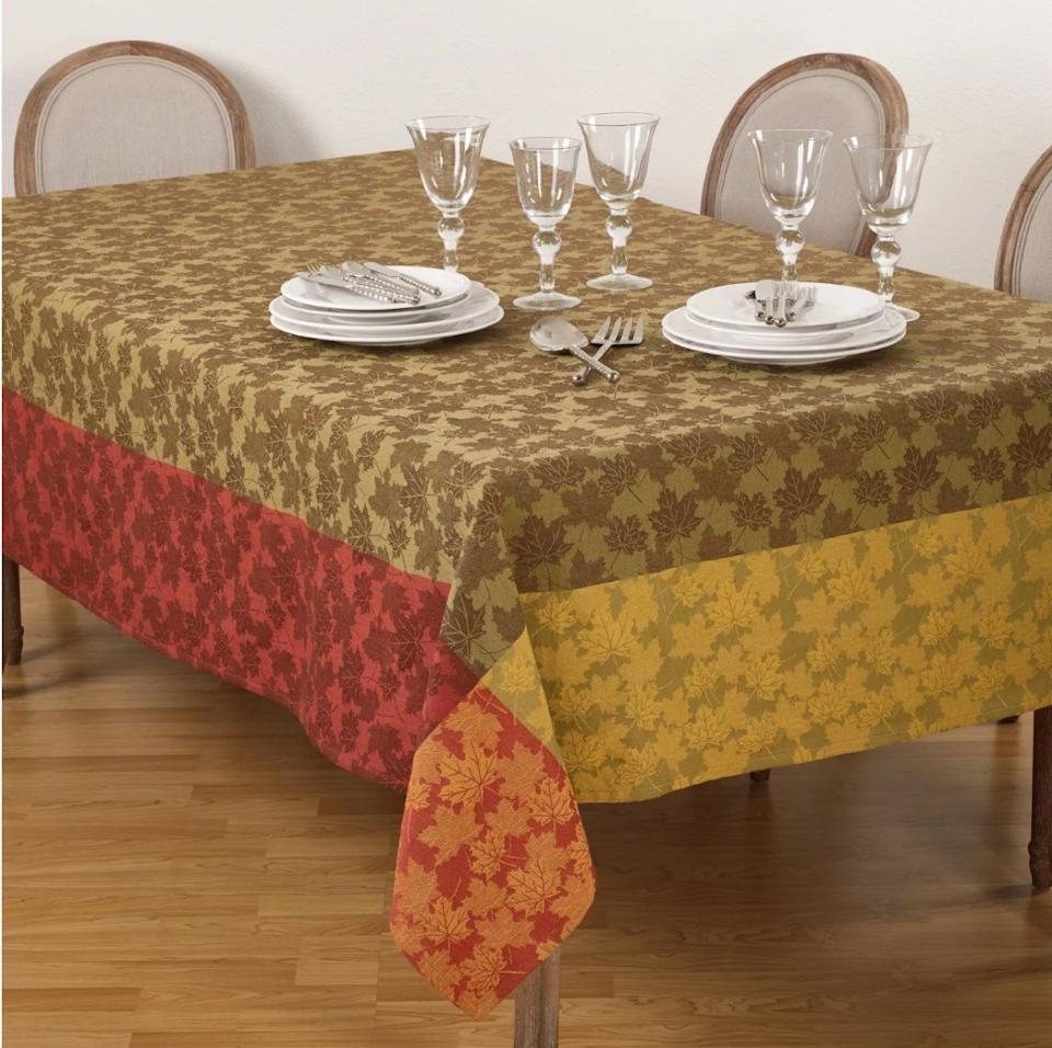 multicolored tablecloth with leaf print, fall decorating tips