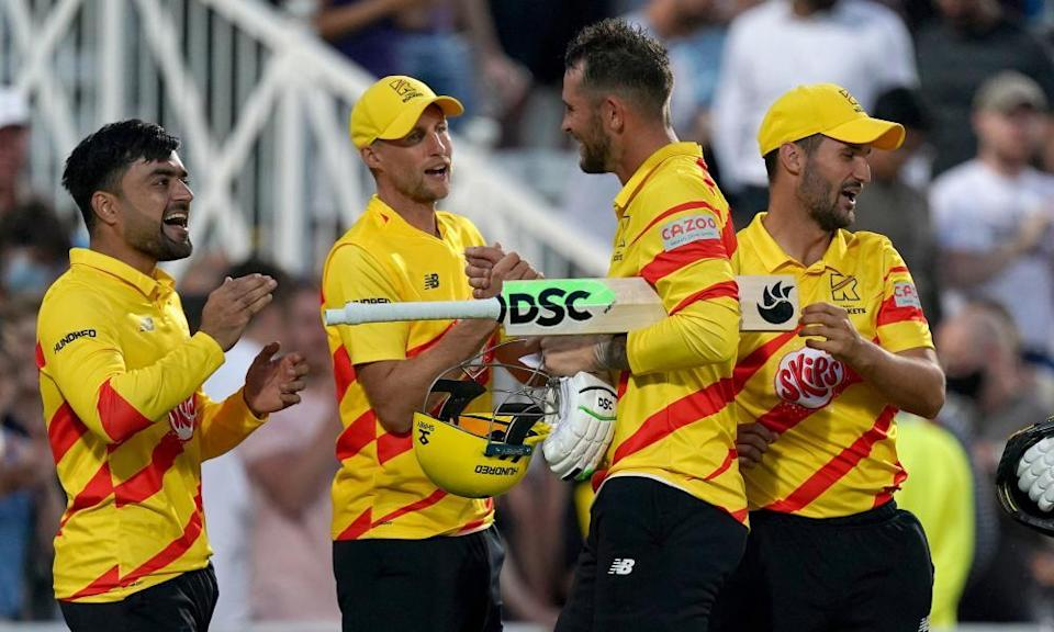 Trent Rockets' Alex Hales (second right) shakes hands with Joe Root as the team celebrate the win after the Hundred match at Trent Bridge last week.