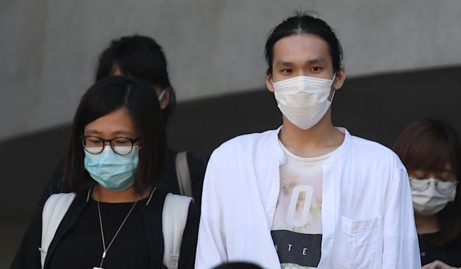 Kan Tsz-pan (right) appears at Kowloon City Court to answer an unlawful assembly charge. Photo: Xiaomei Chen