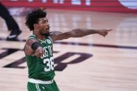 Boston Celtics' Marcus Smart (36) gestures to teammates late in the second half of an NBA conference final playoff basketball game against the Miami Heat on Saturday, Sept. 19, 2020, in Lake Buena Vista, Fla. (AP Photo/Mark J. Terrill)