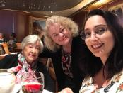 Sydney businesswoman Janet Dixon-Hughes, daughter Polly and her 95-year-old mother Wynne King pose for a photo on the Ruby Princess as the cruise ship sails in international waters