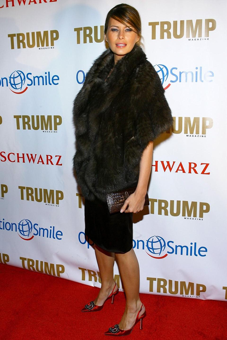 <p>A more covered up look for Melania in 2006 meant a fur throw, simple black dress and red satin Manolo Blahniks. <i>[Photo: Getty]</i> </p>