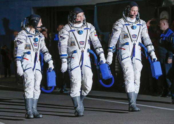 PHOTO: From left, U.S. astronaut Christina Hammock Koch, Russian cosmonaut Alexey Ovchinin, and U.S. astronaut Nick Hague walk in their space suits prior the launch of Soyuz MS-12 space ship at the Baikonur cosmodrome, Kazakhstan, March 14, 2019. (Dmitri Lovetsky/Pool via AP)