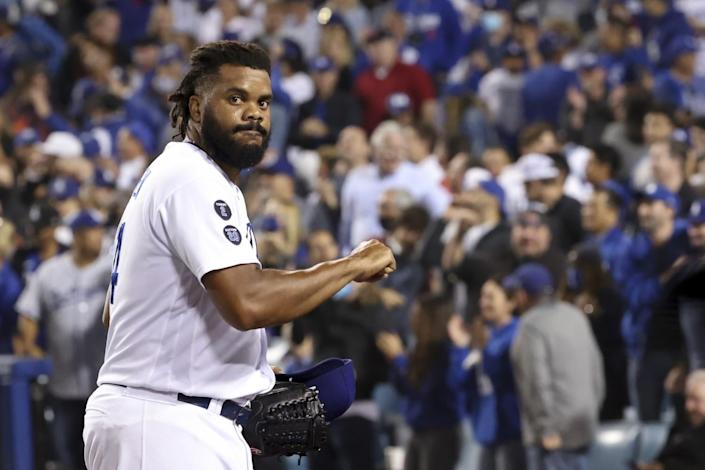 Los Angeles Dodgers relief pitcher Kenley Jansen walks off the field after retiring the side