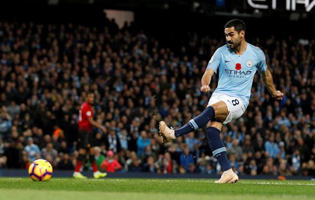 """Soccer Football - Premier League - Manchester City v Manchester United - Etihad Stadium, Manchester, Britain - November 11, 2018 Manchester City's Ilkay Gundogan scores their third goal REUTERS/Darren Staples EDITORIAL USE ONLY. No use with unauthorized audio, video, data, fixture lists, club/league logos or """"live"""" services. Online in-match use limited to 75 images, no video emulation. No use in betting, games or single club/league/player publications. Please contact your account representative for further details."""