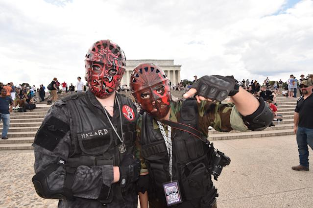 <p>Masked supporters of the US rap group Insane Clown Posse, known as Juggalos, gather on Sept. 16, 2017 near the Lincoln Memorial in Washington to protest at a 2011 FBI decision to classify their movement as a gang. (Photo: Paul J. Richards/AFP/Getty Images) </p>