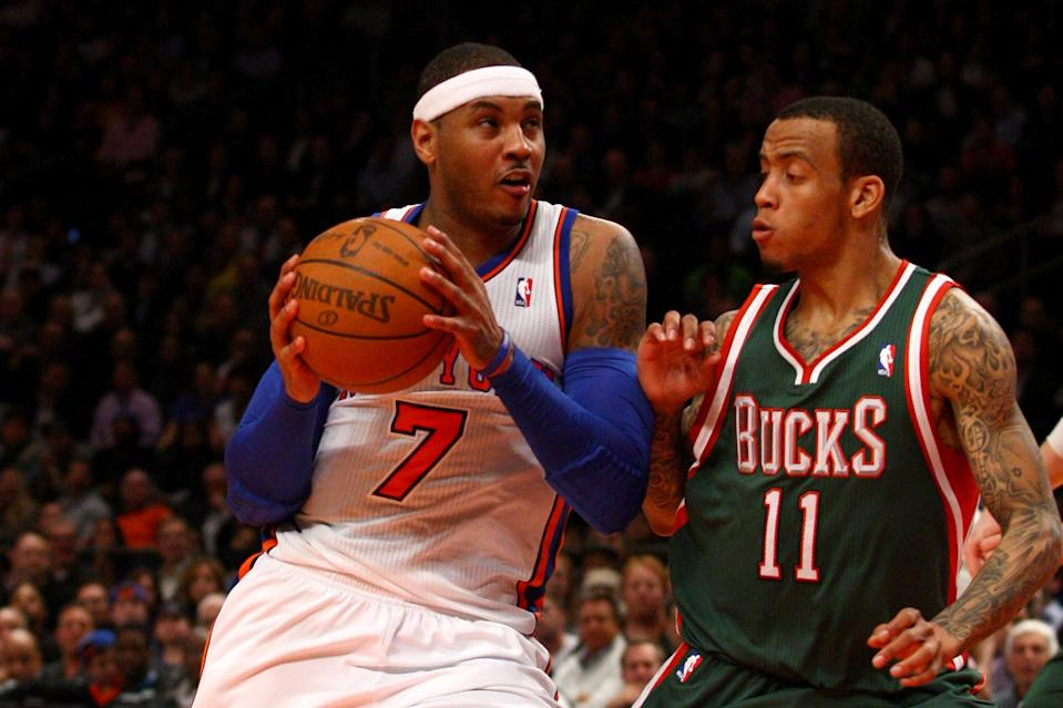 Carmelo Anthony (7) drives in the second half against Monta Ellis of the Milwaukee Bucks at Madison Square Garden on March 26, 2012 in New York. (Photo by Chris Chambers/Getty Images)