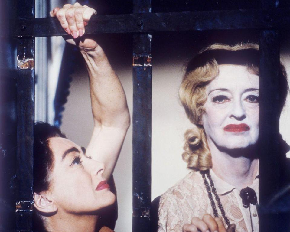 """<p>Davis is pictured alongside her co-star Joan Crawford (left) in a promotional still for the thriller <em>Whatever Happened to Baby Jane? </em>The infamous rivalry between the two actresses came to a head during production, and has since been widely reported upon and adapted in the 2017 FX series <em><a href=""""https://www.townandcountrymag.com/leisure/arts-and-culture/a9676/bette-davis-joan-crawford-feud/"""" rel=""""nofollow noopener"""" target=""""_blank"""" data-ylk=""""slk:Feud: Bette and Joan"""" class=""""link rapid-noclick-resp"""">Feud: Bette and Joan</a></em>.</p>"""