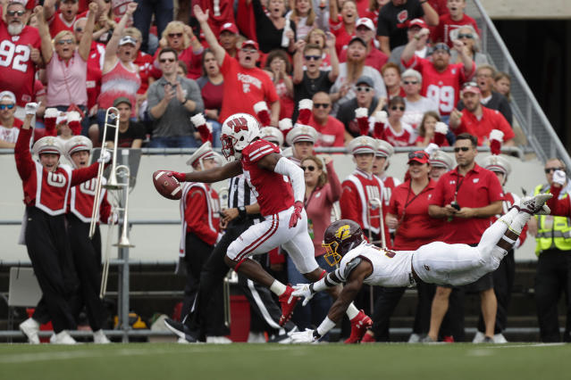 FILE - In this Sept. 7, 2019, file photo, Wisconsin wide receiver Quintez Cephus scores a touchdown against Central Michigan during the first half of an NCAA college football game, in Madison, Wis. Cephus has a team-high 720 yards and six touchdowns on 45 catches and has the 10th-ranked Badgers one win away from capturing their first Big Ten championship since 2012. But less than four months ago, football was gone, and all Cephus had was his faith and his family. (AP Photo/Andy Manis, File)