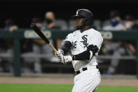 Chicago White Sox's Luis Robert watches his two-run home run during the eighth inning of a baseball game against the Detroit Tigers Monday, Aug. 17, 2020, in Chicago. (AP Photo/Paul Beaty)