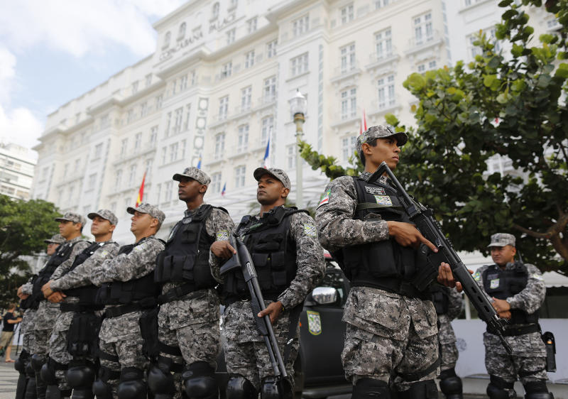 National Force police officers stand guard outside the Copacabana Palace where Ray Whelan, of MATCH Services, is staying, in Rio de Janeiro, Brazil, Tuesday, July 8, 2014. The World Cup corporate hospitality executive was arrested at the Copacabana Palace, the hotel used by FIFA officials during the World Cup. Whelan, who is suspected of involvement with a ticket-scalping ring, was released from prison early Tuesday. (AP Photo/Leo Correa)