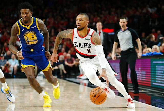 Portland's Damian Lillard, dribbling against Golden State in the NBA playoffs, was named Wednesday as the J. Walter Kennedy Citizenship award winner (AFP Photo/JONATHAN FERREY)