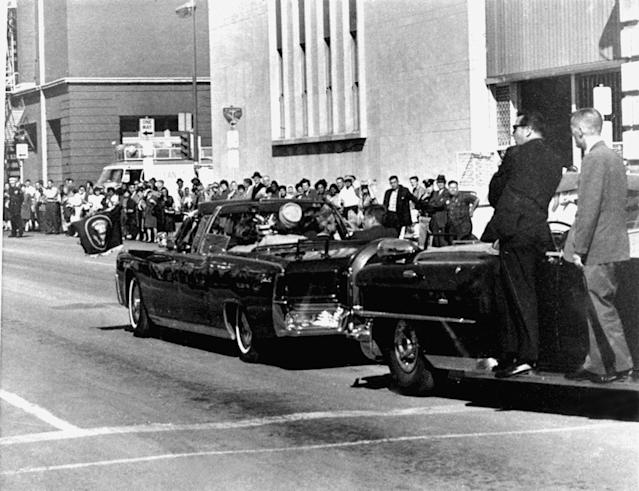 <p>Secret servicemen standing on running boards follow the presidential limousine carrying President John F. Kennedy, right, rear seat, and first lady Jacqueline Kennedy, left, as well as Texas Gov. John Connally and his wife, Nellie, in Dallas, Texas, Nov. 22, 1963. Moments later, President John F. Kennedy was shot by an assassin. (Photo: Jim Altgens/AP) </p>
