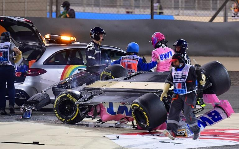 Racing Point's Canadian driver Lance Stroll (3rd-R) is helped into the medical car after crashing during the Bahrain Formula One Grand Prix