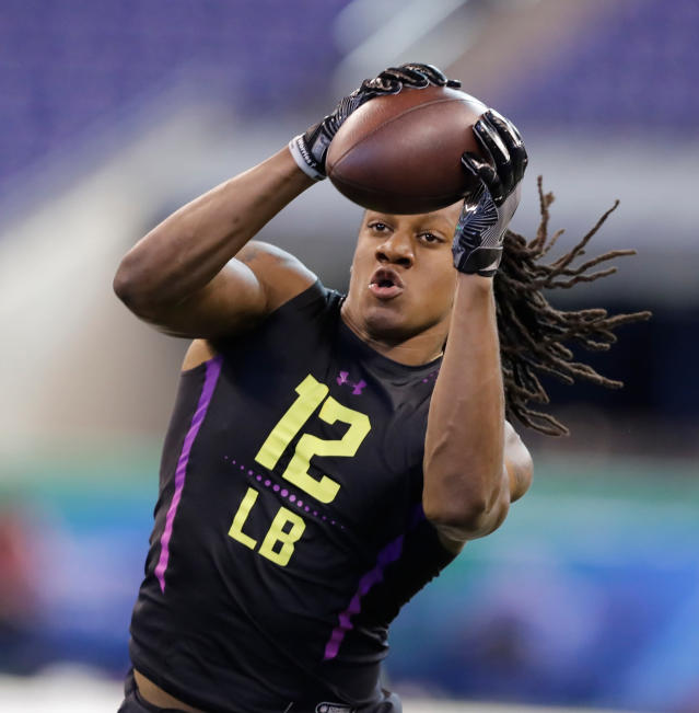 FILE - In this Match 4, 2018, file photo, Virginia Tech linebacker Tremaine Edmunds runs a drill during the NFL football scouting combine, in Indianapolis. Edmunds is expected to be a first round pick in the NFL Draft. (AP Photo/Darron Cummings, File)