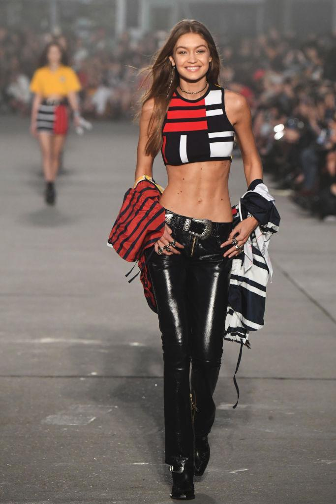 <p>As expected, Gigi Hadid opened the show, wearing latex-like pants and an ultra-cropped striped top. (Photo: Getty Images) </p>