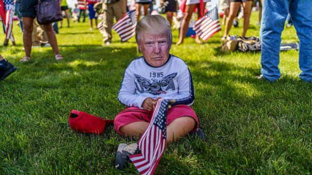 PHOTO: A supporter wears a mask of President Donald Trump on Aug. 17, 2020, in Mankato, Minn. (Kerem Yucel/AFP via Getty Images, FILE)