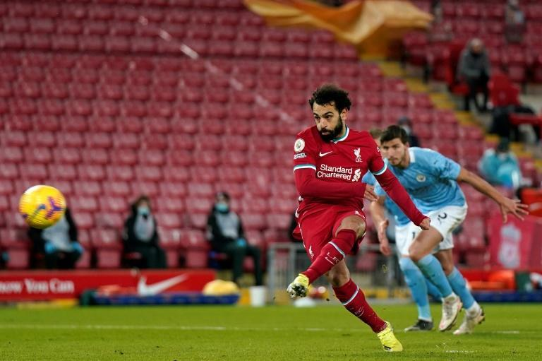 Mohamed Salah levels for Liverpool from a penalty in a 4-1 loss to Manchester City at Anfield.
