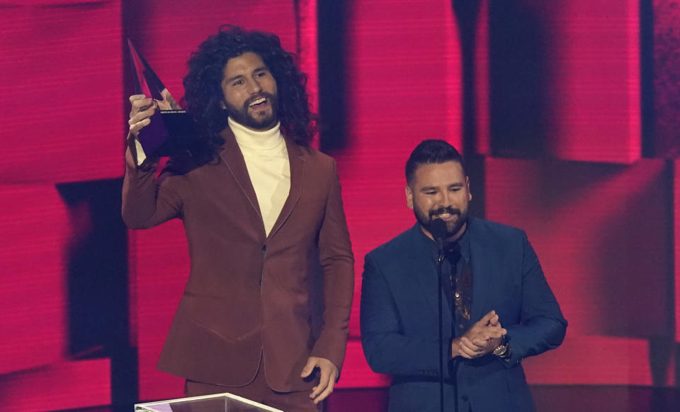 "Dan Smyers, left, and Shay Mooney, of Dan + Shay, accept the award for favorite country song for ""10,000 Hours"" at the American Music Awards on Sunday, Nov. 22, 2020, at the Microsoft Theater in Los Angeles. (AP Photo/Chris Pizzello)"
