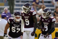 Mississippi State wide receiver Tyrell Shavers (9) celebrates his touchdown reception with running back Kylin Hill (8) and offensive lineman Cole Smith (57) in the first half an NCAA college football game against LSU in Baton Rouge, La., Saturday, Sept. 26, 2020. (AP Photo/Gerald Herbert)