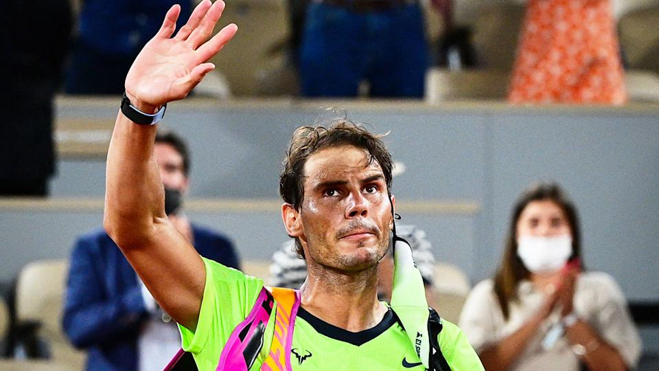 Seen here, Rafael Nadal waves to the crowd after being knocked out of the French Open.