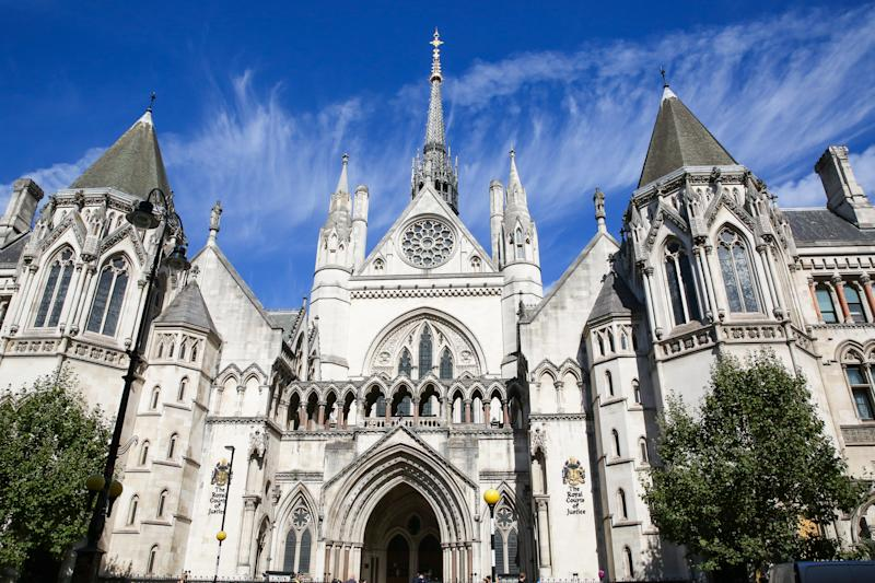 LONDON, UNITED KINGDOM - 2019/09/13: An exterior view of the Royal Courts of Justice in London. The Royal Courts of Justice, commonly called the Law Courts, is a court building in London which the High Court and Court of Appeal of England and Wales. The High Court also sits on circuit and in other major cities. (Photo by Dinendra Haria/SOPA Images/LightRocket via Getty Images)
