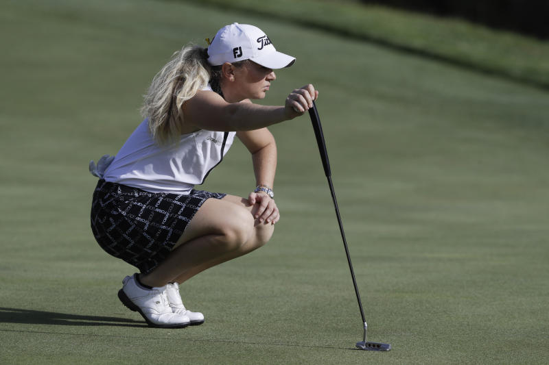 Bronte Law, of England, looks at a putt on the sixth green during the first round of the Indy Women in Tech Championship golf tournament, Thursday, Sept. 26, 2019, in Indianapolis. (AP Photo/Darron Cummings)