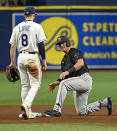 Miami Marlins' Nick Fortes, right, looks at Tampa Bay Rays infielder Brandon Lowe (8) after he stole second base during the fourth inning of a baseball game Saturday, Sept. 25, 2021, in St. Petersburg, Fla. (AP Photo/Steve Nesius)