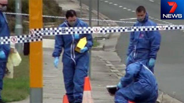 Officers wearing forensic suits on the scene of the police shooting in West Hoxton. Photo: 7News