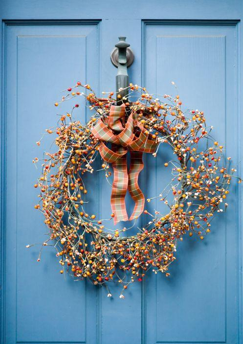 """<p>Adorn a wreath made of berries with a plaid ribbon that matches the rest of your <a href=""""https://www.countryliving.com/home-design/decorating-ideas/g2621/fall-porch-decorating/"""" rel=""""nofollow noopener"""" target=""""_blank"""" data-ylk=""""slk:fall front porch decor"""" class=""""link rapid-noclick-resp"""">fall front porch decor</a>.</p>"""