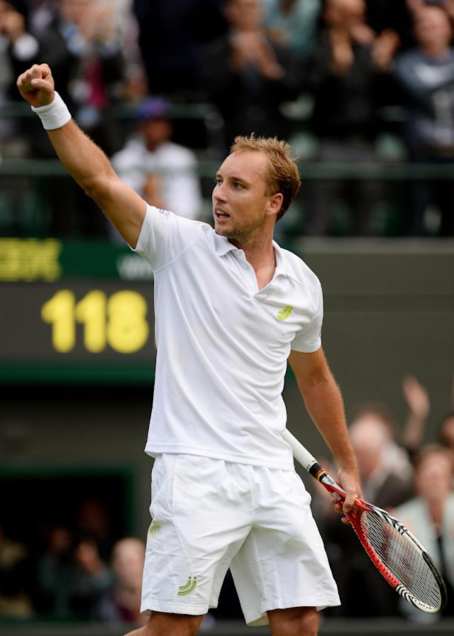LONDON, ENGLAND - JUNE 24: Steve Darcis of Belgium salutes the crowd as he celebrates match point during his Gentlemen's Singles first round match against Rafael Nadal of Spain on day one of the Wimbledon Lawn Tennis Championships at the All England Lawn Tennis and Croquet Club on June 24, 2013 in London, England. (Photo by Mike Hewitt/Getty Images)