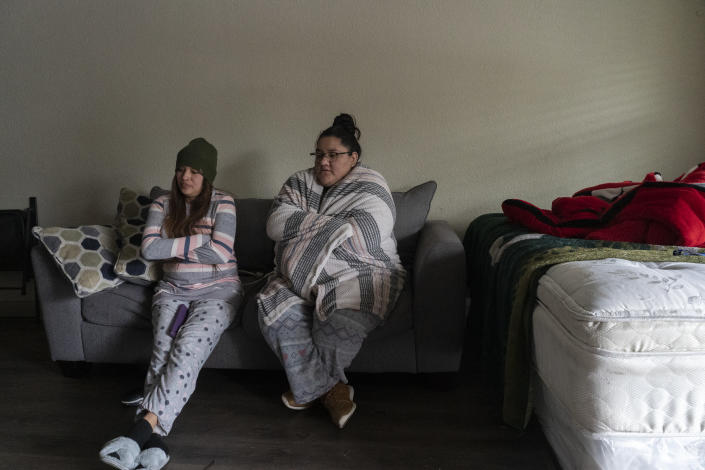 Karla Perez and Esperanza Gonzalez stay in their apartment during power outage caused by the winter storm on February 16, 2021 in Houston, Texas. (Photo by Go Nakamura/Getty Images)