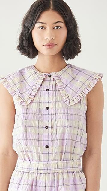 <p>We love the check print and statement collar on this <span>Ganni Seersucker Check Shirt</span> ($165). Wear with denim or go for the matching short set. </p>
