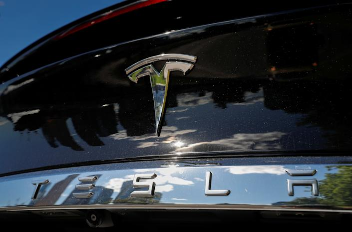 The company logo is pictured on a Tesla Model X electric vehicle in this picture illustration taken in Moscow, Russia July 23, 2020. Picture taken July 23, 2020. REUTERS/Evgenia Novozhenina