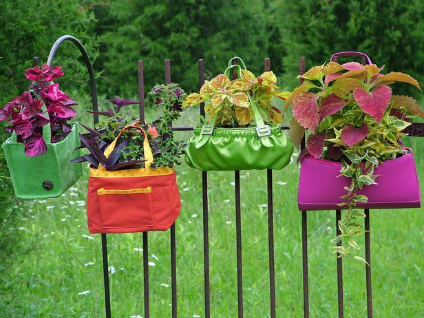 """<div class=""""caption-credit"""">Photo by: Nancy Ondra</div><div class=""""caption-title"""">A Hanging Garden</div>Colorful purses, small tote bags and other handled handbags make fun and fashionable plant holders. Lining them with plastic will keep the potting soil from staining the fabrics. Hang the handles from hooks on a wall, slip them over fence posts or dangle them from tree branches."""